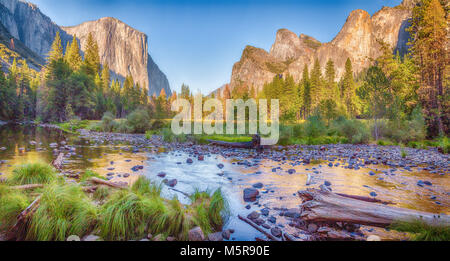 Panoramic view of famous Yosemite Valley with scenic Merced river in beautiful golden evening light at sunset in summer, Yosemite National Park, Marip Stock Photo