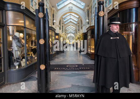 A caped doorman at Burlington Arcade in Central London - Stock Photo