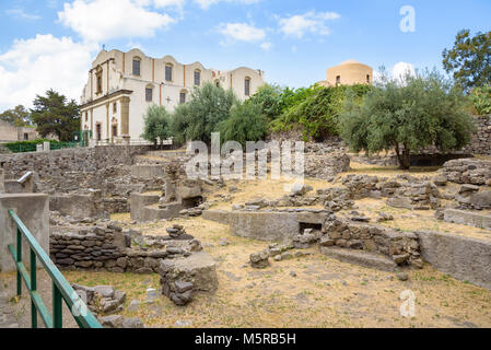 Ruins of the ancient huts and the Church of the Immaculate in Lipari, Aeolian Islands, Italy - Stock Photo