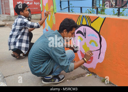 Guwahati, India. 25th Feb, 2018. Artists painting on wall for the beautification of Guwahati city under smart city - Stock Photo