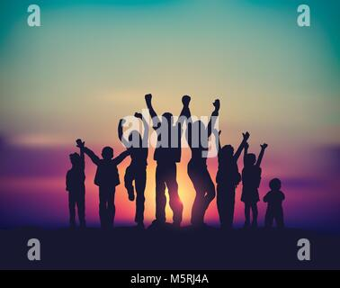 Many children happy family group and sunrise sky silhouettes. - Stock Photo