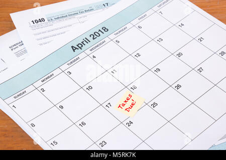 Calendar with reminder for taxes due on April 17th - Stock Photo