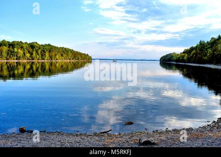 A calm bay stretches between two peninsulas in Point Au Roche State Park on Lake Champlain, in New York. - Stock Photo