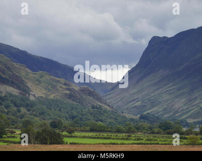 Clouds building over Honister Pass and Fleetwith Pike in the English Lake District, UK. - Stock Photo