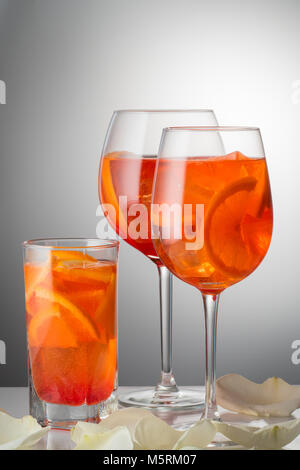 Summer refreshing faintly alcoholic cocktail Aperol spritz in a  - Stock Photo