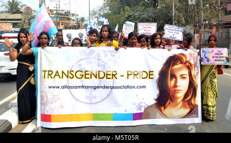 Guwahati, Assam, India. 25th Feb, 2018. Transgender community members and supporters walk during a protest against - Stock Photo