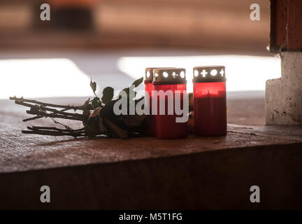 24 February 2018, Germany, Dortmund: Flowers and candles are placed in a parking deck at the railway station Hoerde. - Stock Photo