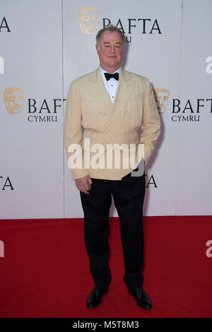 Actor Owen Teale poses for a picture at the 26th British Academy Cymru Awards held at St David's Hall on October - Stock Photo