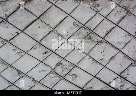 Plaster wall with metal grid mesh on it - Stock Photo