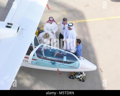 AL AIN, UAE - DECEMBER 29, 2004: Men inspecting an aircraft at the Al Ain Aerobatics Show in Al Ain, United Arab - Stock Photo