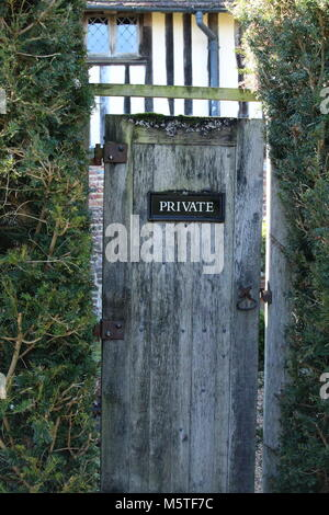 Private No Entry sign, on a garden gate set within estate and formal gardens of medieval manor house. - Stock Photo