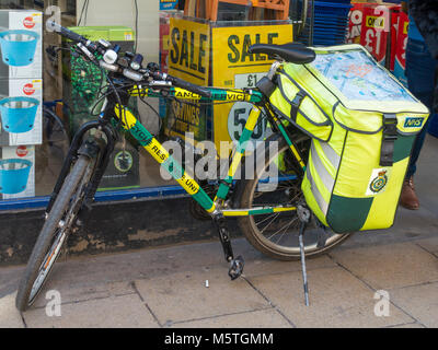 NHS National Health Service Emergency Response Ambulance service bicycle for providing support in city centre not - Stock Photo
