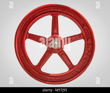 Close Up of a Large Red Industrial Opening Wheel Isoalted - Stock Photo