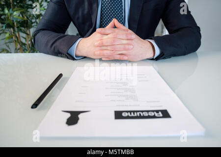 Executive hands ready to sign a job contract - Stock Photo