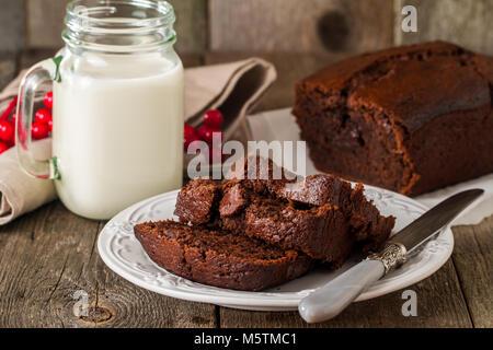 Chocolate-banana Loaf cake on paper   - Stock Photo