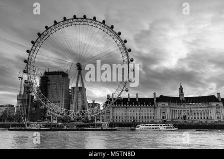 The London Eye and County Hall at dawn from Victoria Embankment - Black & White - Stock Photo
