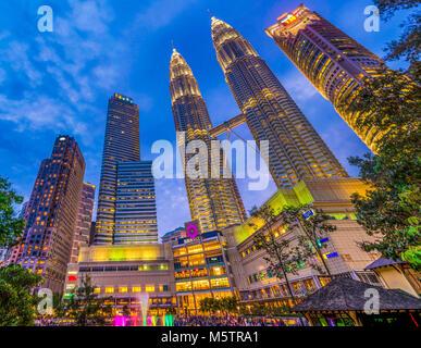 Kuala Lumpur neon night Petronas Towers KLCC Park illuminated Malaysia - Stock Photo