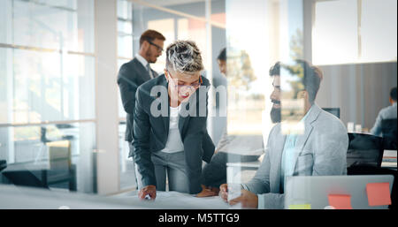 Group of business people collaborating and working on project - Stock Photo