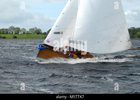 A Water Wag dinghy races towards Roosky on the Shannon River in Ireland. Swiss Olympic sailor Albert Schiess is - Stock Photo