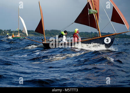 Two sail boats race down Lough Ree during the first Irish sailing raid on the Shannon River in Ireland. - Stock Photo
