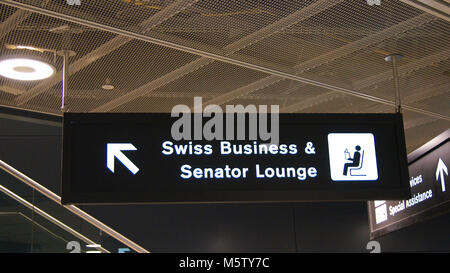 ZURICH, SWITZERLAND - MAR 31st, 2015: airport sign to SWISS Business and Senator Lounge inside the terminal building - Stock Photo