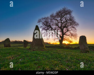 spectacular sunset on a bitterly cold day at The Grey Ladies / Nine Stone Close Stone Circle, Robin Hood's Stride - Stock Photo