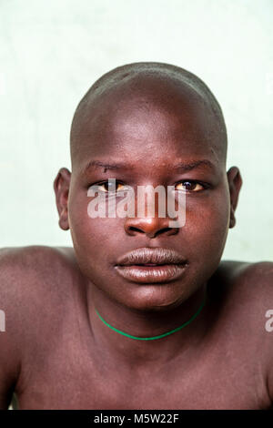A Portrait Of A Young Man From The Bodi Tribe, Bodi Village, Omo Valley, Ethiopia - Stock Photo