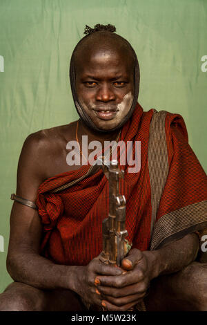A Portrait Of A Young Man From The Mursi Tribe, Mursi Village, Omo Valley, Ethiopia - Stock Photo