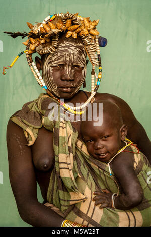 A Portrait Of A Mother and Baby From The Mursi Tribe, Mursi Village, Omo Valley, Ethiopia - Stock Photo