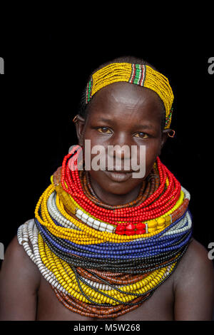 A Portrait Of A Young Woman From The Nyangatom Tribe, Lower Omo Valley, Ethiopia - Stock Photo