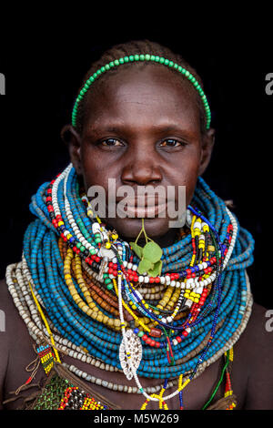 A Portrait Of A Woman From The Nyangatom Tribe, Lower Omo Valley, Ethiopia - Stock Photo