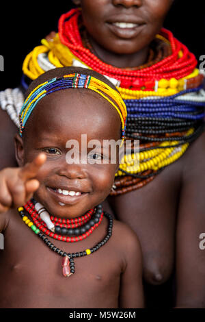 A Portrait Of A Young Mother and Baby From The Nyangatom Tribe, Lower Omo Valley, Ethiopia - Stock Photo