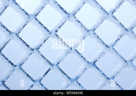winter lattice in the frost texture metal rhombus - Stock Photo