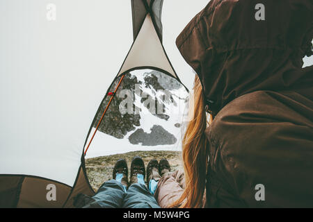 Travel couple in tent camping relaxing inside Lifestyle concept adventure vacations outdoor - Stock Photo