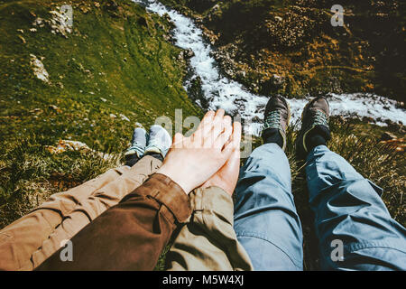 Couple in love holding hands relaxing together on mountain summit Travel happy emotions Lifestyle concept adventure - Stock Photo