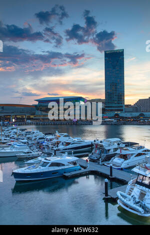 Sofitel Hotel and International Convention Centre at sunset, Darling Harbour, Sydney, New South Wales, Australia - Stock Photo