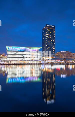 Sofitel Hotel and International Convention Centre at dusk, Darling Harbour, Sydney, New South Wales, Australia - Stock Photo
