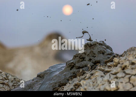 Active mud volcanoes in Gobustan desert, Azerbaijan - Stock Photo