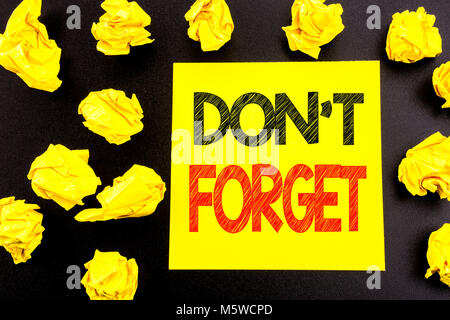 Conceptual hand writing text showing Do Not Forget. Business concept for Don t memory Remider written on sticky - Stock Photo