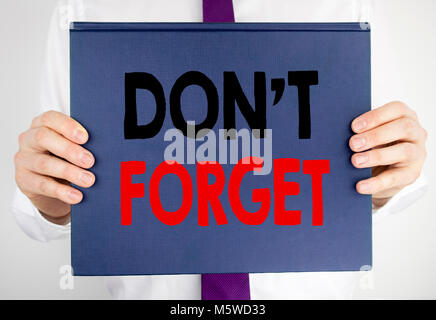 Writing text showing Do Not Forget. Business concept for Don t memory Remider written on book notebook paper holding - Stock Photo