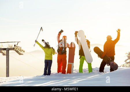 Group of happy skiers and snowboarders having fun - Stock Photo
