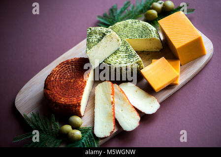 Mix cheese on wooden cutting board.Top view. - Stock Photo