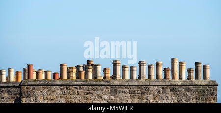 Row of old chimney pots on a house in Edinburgh, Scotland, United Kingdom - Stock Photo