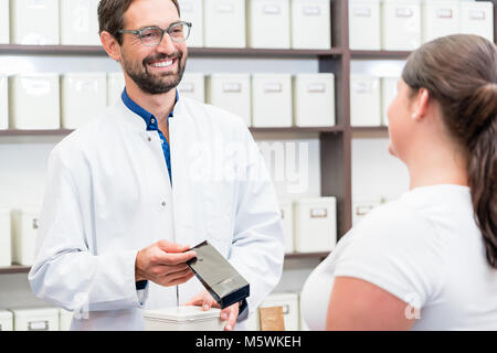 Woman shopping alternative drugs at herbalist - Stock Photo