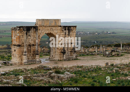Volubilis near Meknes in Morocco. Volubilis is a partly excavated Amazigh, then Roman city in Morocco situated near - Stock Photo