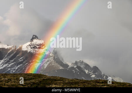 Spectacular rainbow over Cuernos del Paine; 2,000m; near Refugio Grey; Torres del Paine National Park; Chile - Stock Photo
