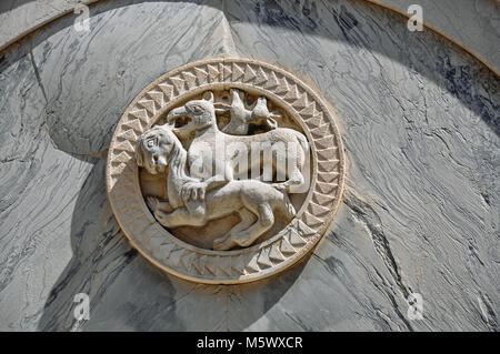 Close-up of embossed marble sculpture of animals on facade of old building in the city center of Venice, the historic - Stock Photo