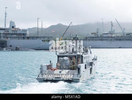 Sailors assigned to Coastal Riverine Squadron (CRS) 4, Det. Guam transit Apra Harbor aboard a Mark VI patrol boat - Stock Photo