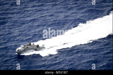 A Mark VI patrol boat assigned to Coastal Riverine Group 1, Det. Guam transits the Pacific Ocean following a search - Stock Photo