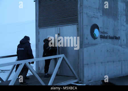 Longyearbyen, Norway. 26th Feb, 2018. People stand at the entrance of the Svalbard Global Seed Vault in Longyearbyen, - Stock Photo